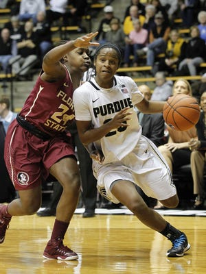 April Wilson tries to get past Shankena Richardson of Florida State in the ACC/Big Ten Challenge Wednesday, December 3, 2014, at Mackey Arena. Purdue lost to FSU 67-64 in overtime.