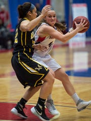 Millersville's Tyisha White guards Logan Snyder of Shippensburg as she tries to pass the ball during the PSAC Quarterfinals in Shippensburg, Pa. on Tuesday, March 1, 2016. Shippensburg defeated Millersville 58-56
