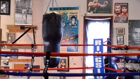 Muhammad Ali posters and pictures hang on the walls