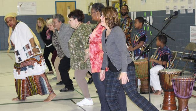 During a recent assembly, Quarter Mile Lane School celebrated Black History Month with presenters from the Seventh Principle. Staff and students participated in West African dances, played instruments and learned about African culture.