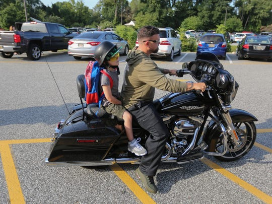 Nick Hower gave his 7-year-old son Nick, a first-grader, a ride on his motorcycle to his first day of school at Pleasantville Elementary School Monday morning.