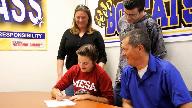 Bloomfield High School's Ashley Lewellen signs her letter of intent Thursday to continue her softball career at Mesa Community College.