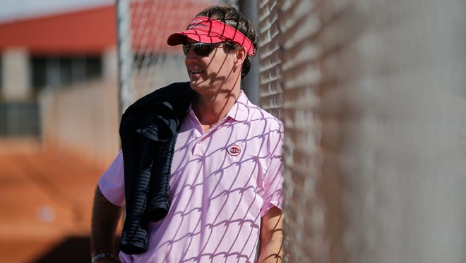 Cincinnati Reds general manager Dick Williams talks with a fan and watches batting practice during Cincinnati Reds spring training, Friday, Feb. 17, 2017, at the Cincinnati Reds player development complex in Goodyear, Arizona.