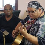 Members of  the Americana Community Music Association perform at All Faiths Unitarian Church on Sunday during their weekly songwriting circle.