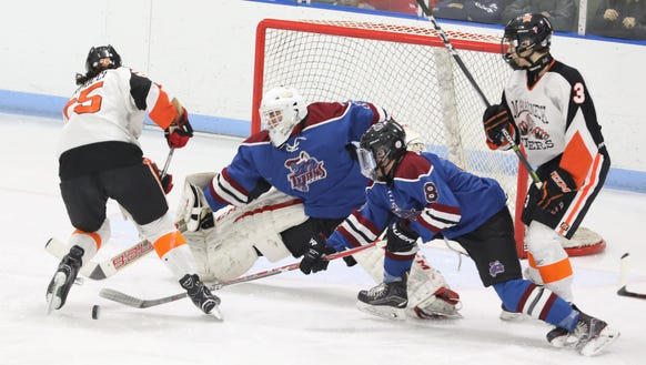 Mamaroneck's Michael Carducci tries to get a shot off