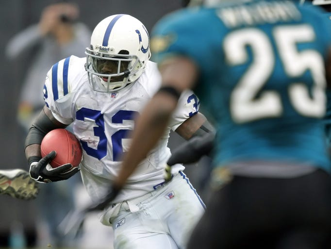 Edgerrin James cuts through the Jaguar defense for