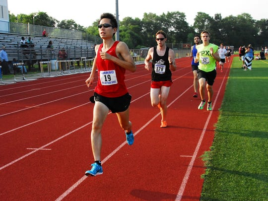 Poughkeepsie's Mike Chow wins a race during the 2014