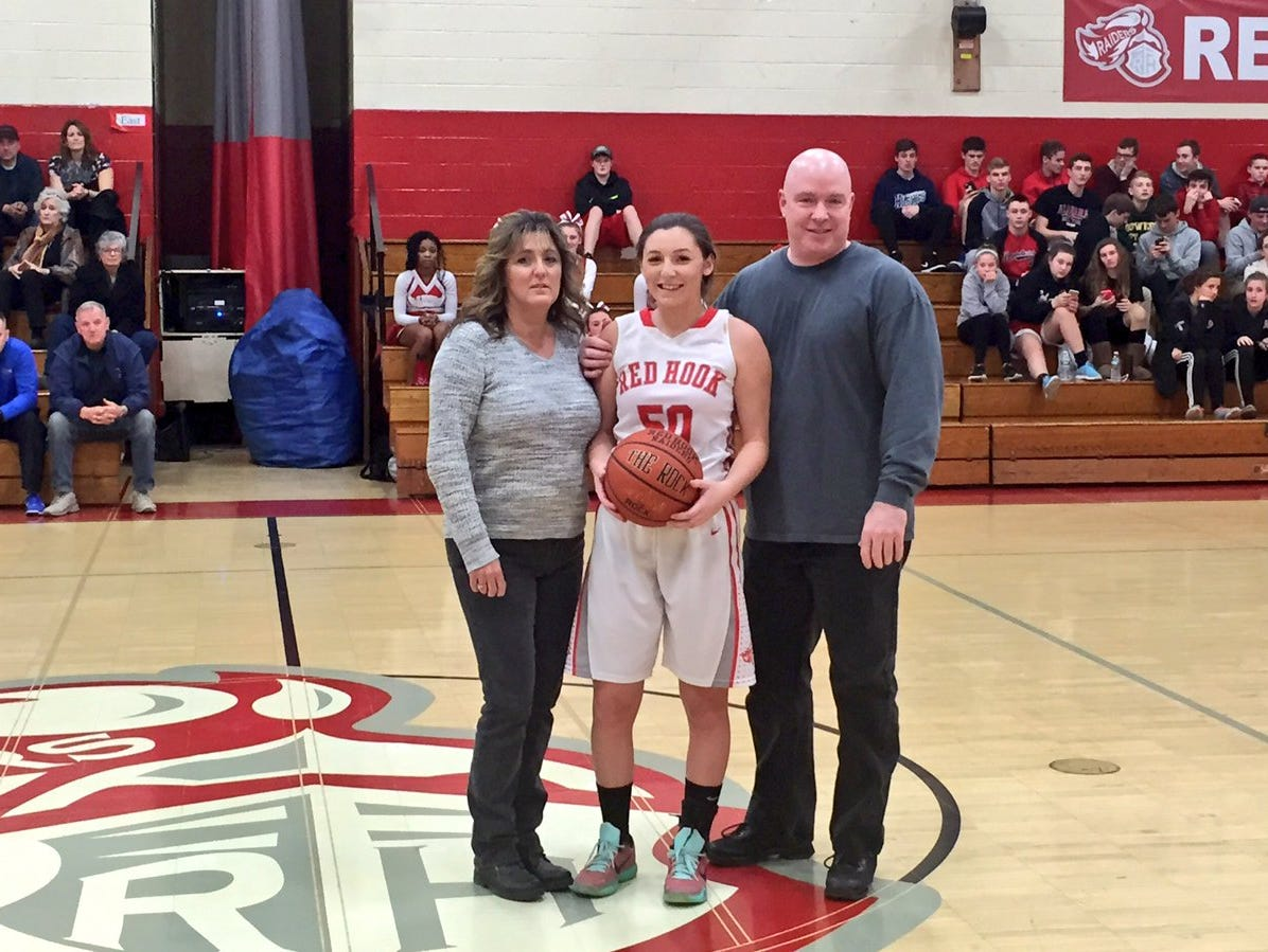 Jessica Wilkinson broke the Red Hook scoring record, reaching 1,515 points on a layup with 2:53 left in the third quarter of Monday's game against Millbrook.