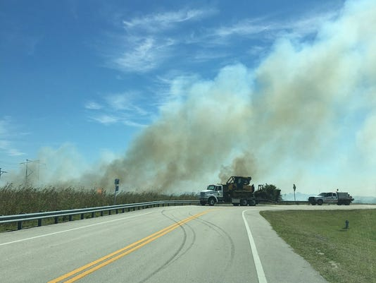 Brush fire in West Cocoa