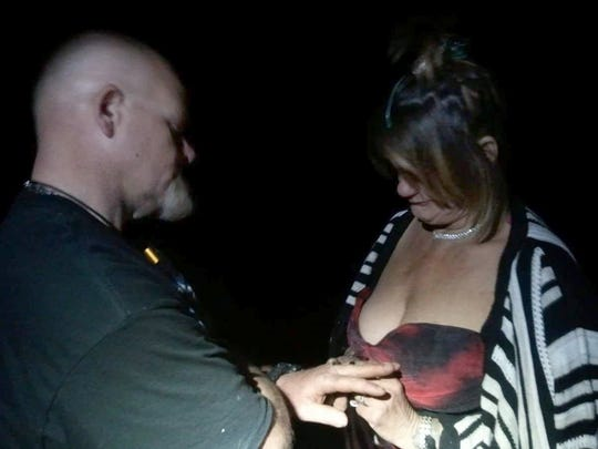 Michael and Sharon, known as Hillbilly and Moma D, exchange rings at their wedding held in the homeless camp in 2016. Sharon died of an overdose a few months later.
