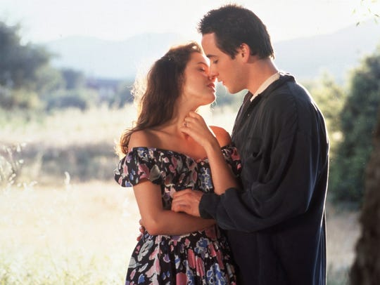 """Ione Sky and John Cusack in a scene from """"Say Anything."""""""