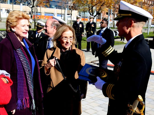 Senator Debbie Stabenow and Barbara Levin, the sponsor of the USS Detroit and wife of retired Senator Carl Levin, listen to Commanding Officer of the USS Detroit, Michael Desmond talk at the end of the commissioning ceremonies of the ship.