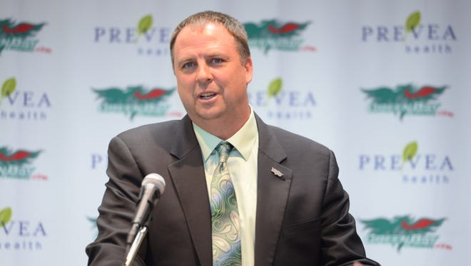UWGB men's basketball coach Linc Darner speaks to the media at his introductory press conference.