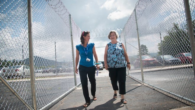 Assistant chaplain Shannon Spencer enters the women's prison with Carol Dalton, chaplain