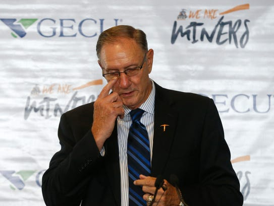 UTEP Athletic Director Bob Stull wipes a tear from