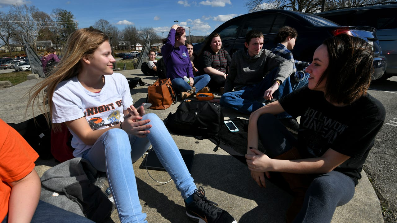 Several students at Lenoir City High School participated in a walkout Tuesday morning to discuss fears and solutions around school shootings.