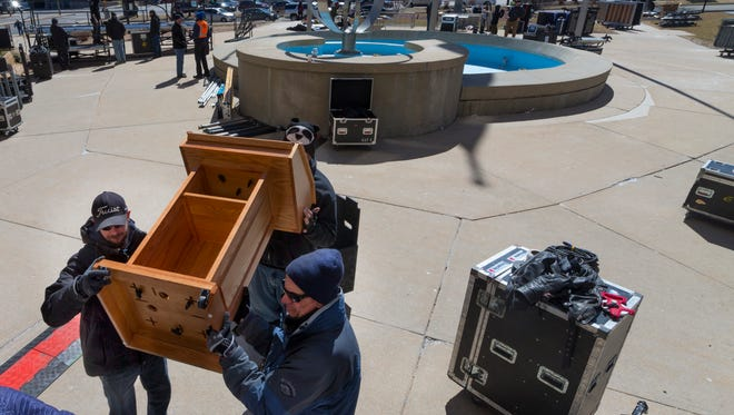Workers move a podium into place in advance of the March for Our Lives on the south side the Milwaukee County Courthouse. Ravina Sachdev, a Brookfield Central High School student is active in March for Our Lives and helped organize the walk out. She is holding an evening of Solidarity on May 30 to honor gun violence victims.