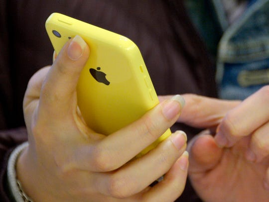 A 2013 file photo shows a person using an Apple iPhone