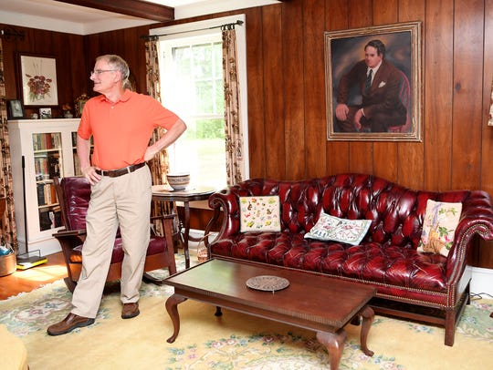 Jim Stokely stands in the home of his mother, Wilma