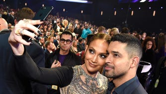 The people have spoken! Check out the celebrities on the People's Choice Awards 2017 red carpet, at Microsoft Theater, on Jan. 18, 2017 in Los Angeles. Jennifer Lopez and actor Wilmer Valderrama  make time for selfies.