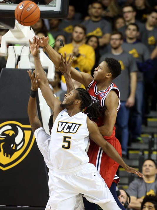 VCU's Doug Brooks (5) and Duquesne's Eric James go after a rebound during the first half of an NCAA college basketball game at VCU in Richmond, Va., Wednesday, Jan. 20, 2016. (Daniel Sangjib Min/Richmond Times-Dispatch via AP)