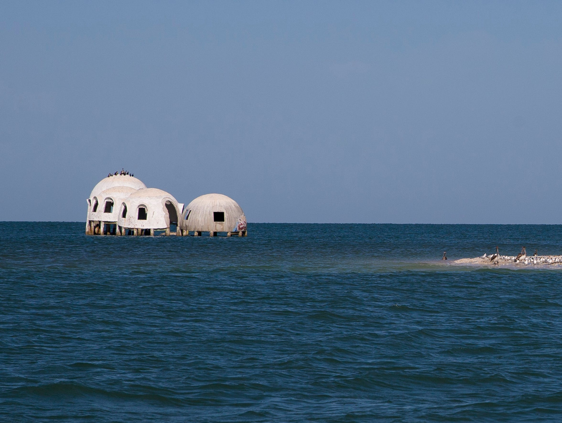The Cape Romano domes, two of which have recently submerged,