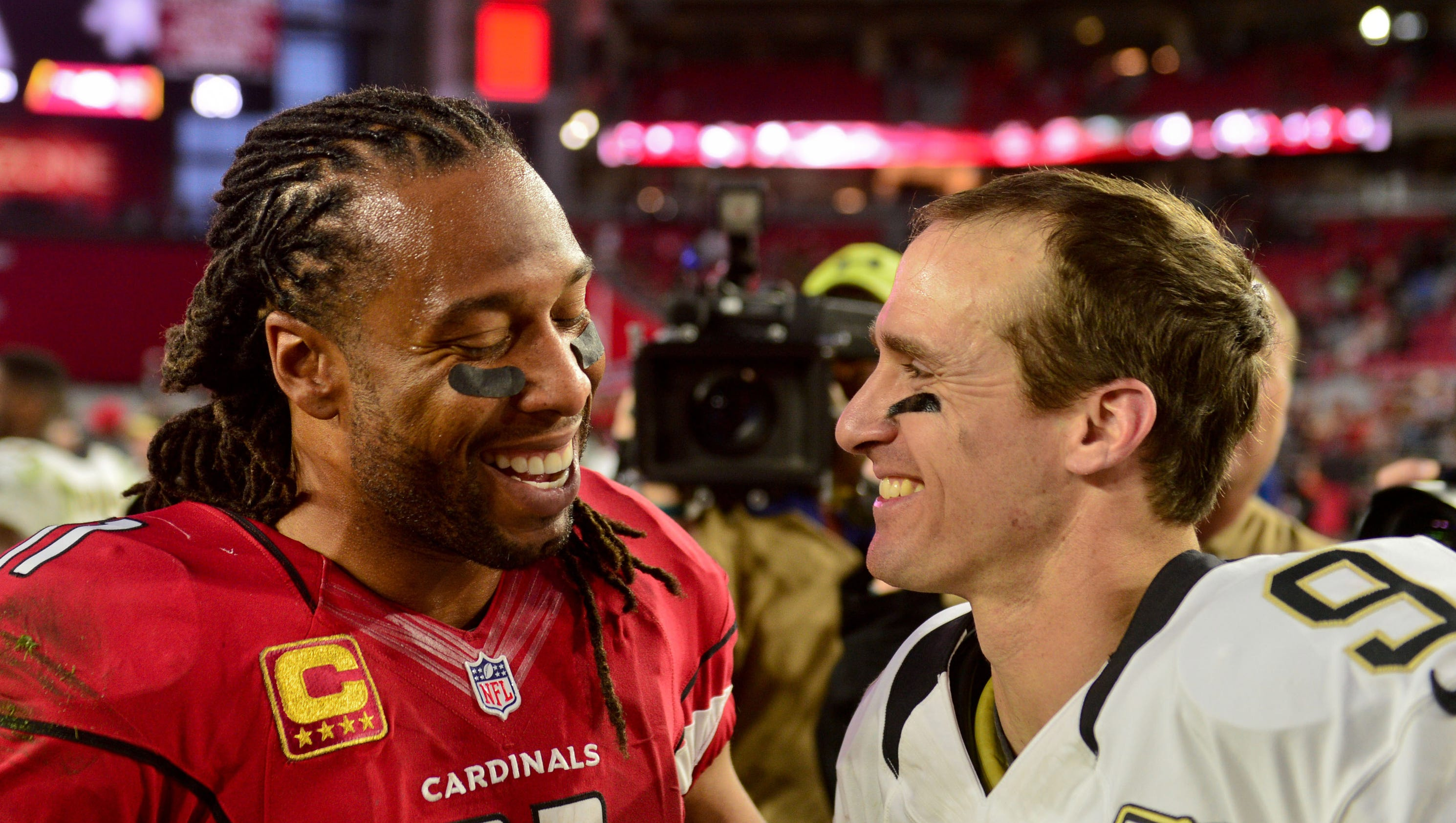 636531674475260899-larry-fitzgerald-drew-brees
