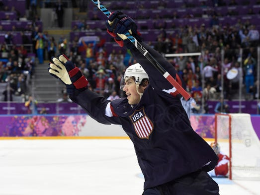 USA forward T.J. Oshie (74) reacts after scoring a goal past Russia goalkeeper Sergei Bobrovski (72) in the overtime shootout.