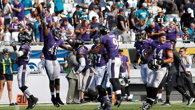 The Baltimore Ravens celebrate after beating the Jacksonville Jaguars 19-17 at EverBank Field.