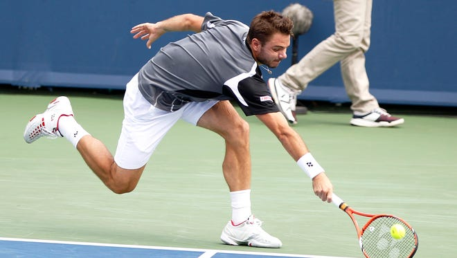 Stan Wawrinka of Switzerland gives his all to make a hit from Marin Cilic of Croatia on Center Court during the Western and Southern Open at the Lindner Family Tennis Center.