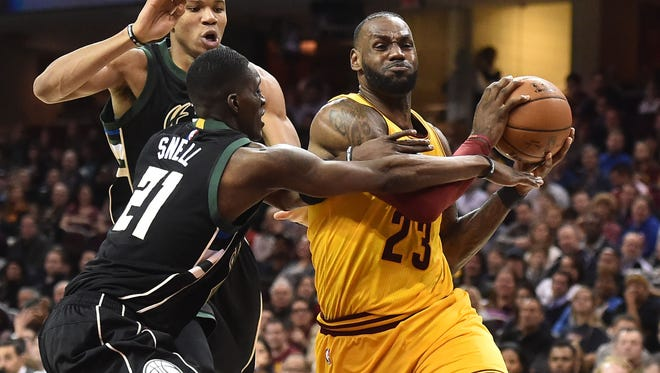 Cleveland Cavaliers forward LeBron James (23) drives to the basket against Milwaukee Bucks guard Tony Snell (21) during the second half at Quicken Loans Arena.