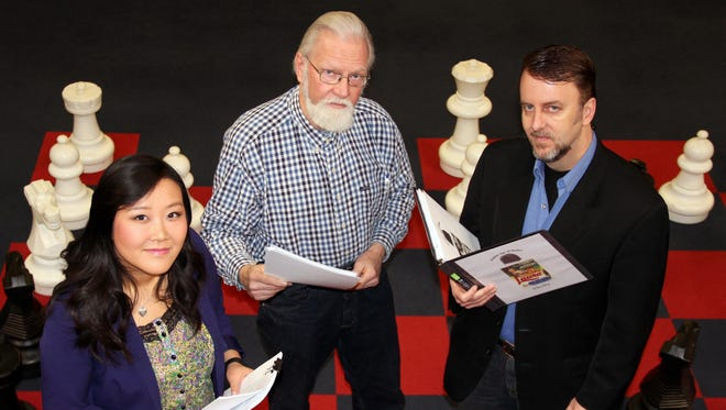 "From left, Megan Zhang (Laura Hunt), Ken Corey (Mark McPherson) and Ted M.W. Rich (Shelby Carpenter) star in ""Laura,"" part of the Elmira Little Theatre show ""Mystery, Comedy and Romance in the Golden Age of Radio."""