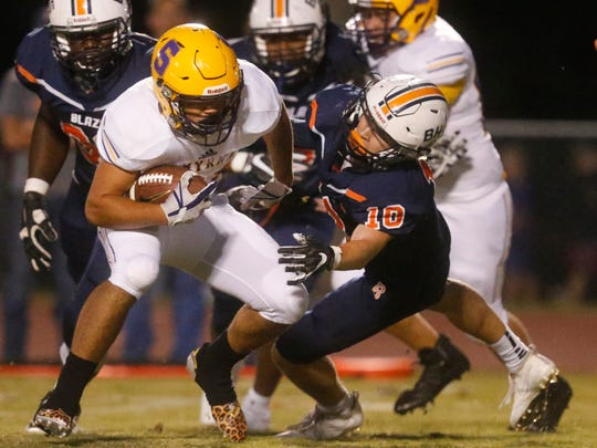 Smyrna's Blake Watkins (21) runs the ball as Blackman's Matthew Hall (10) moves in for the tackle during the game, on Friday, Sept. 8, 2017, at Blackman.
