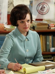 Elisabeth Moss as Peggy Olson, the secretary who rose