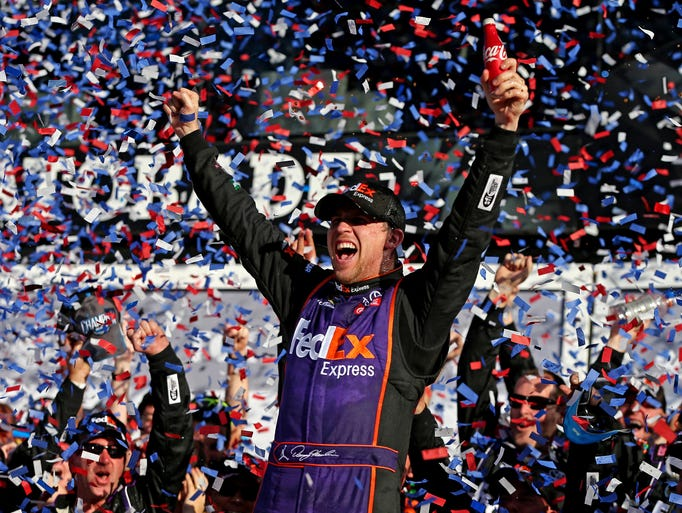 Denny Hamlin celebrates after winning his first career