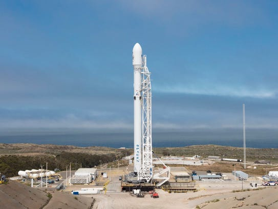 A SpaceX Falcon 9 rocket standing on its pad before