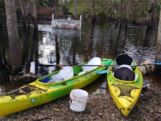 The kayaks used by volunteers to haul debris