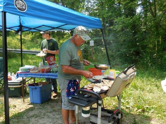 Mark VanBogelen has a great time grilling lunch at