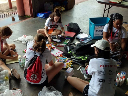 """UL Soul Camp 2017 students sort supplies for United Way of Acadiana's """"Stuff the Bus"""" program."""