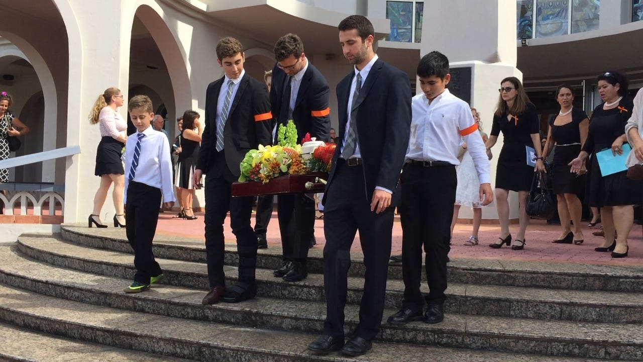 Family members carry the remains of former senator and businessman Al Ysrael after a funeral service at the Dulce Nombre de Maria Cathedral-Basilica in Hagatna on March 27, 2017.