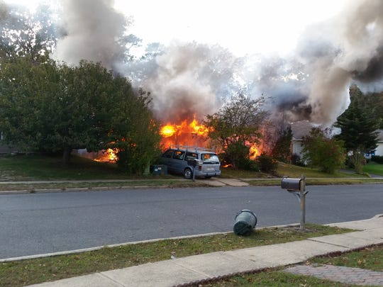 Theresa Froumy snapped this photo of Benjamin Morrow's house before firefighters arrived.
