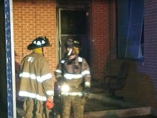 Firefighters battle a blaze late Tuesday night in Opelousas.
