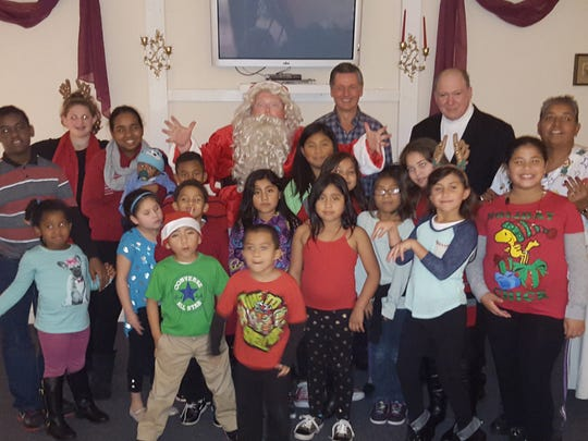 A group of children calling themselves Santa's Little Helpers hosted a Christmas party for local kids in Vineland.