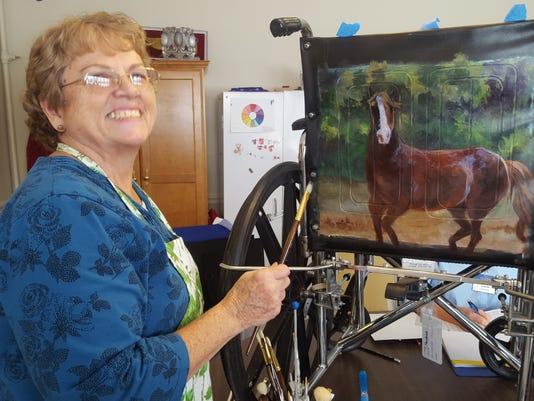 635912148599009973-Artist-with-wheelchair.jpg