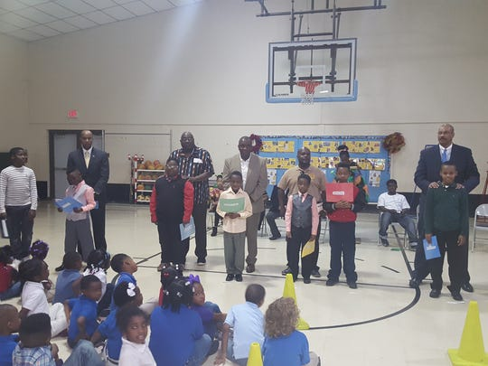 Community members join Julius Patrick Elementary students for a Black History Month events Feb. 19.