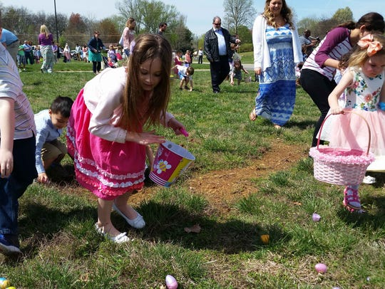 Children race for eggs at the Easter Experience at