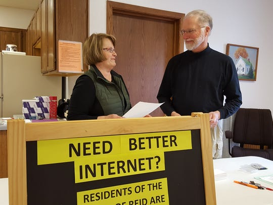 Brenda Budleski (left) and Chuck Krueger volunteered all day at the Reid Town Office on April 5, 2016, educating voters about bringing faster, more reliable internet to Reid.