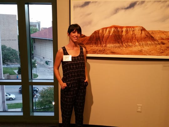 Photographer Sarah Wilson with one of her portraits of the remote park. Her work at Big Bend led to a passion for archaeology and a new connection with her grandfather - renowned University of Texas paleontologist Jack Wilson.