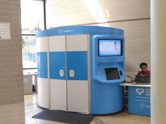 A telemedicine kiosk is outfitted with touchscreens,