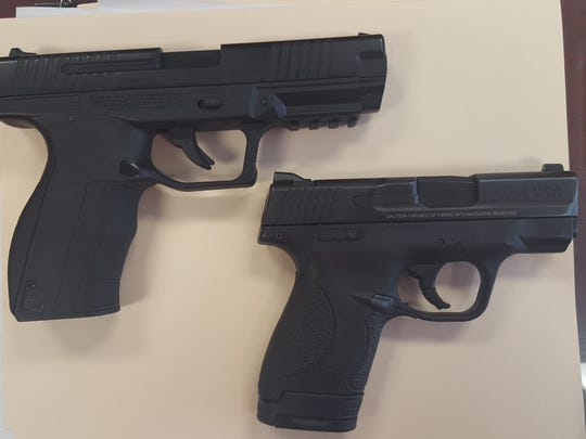Gibson County Sheriff Paul Thomas said the BB gun found in a student's car in August at South Gibson County High School looked like a real gun. He took this photo of the BB pistol next to his service weapon for comparison. Columbus, Ohio, Police Chief Kim Jacobs said a BB gun carried by a 13-year-old boy who was shot and killed Wednesday looks 'practically identical' to police service weapons.